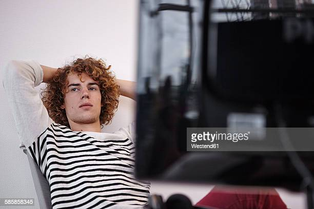 Young man in office thinking