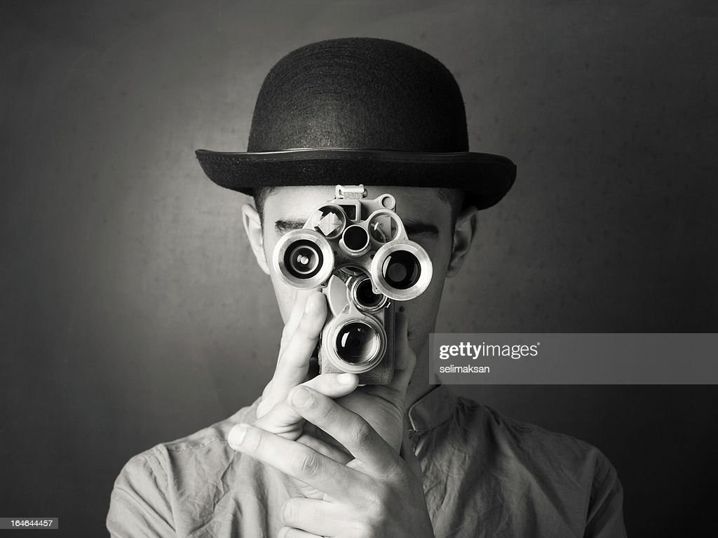 Young Man In Old Fashioned Style Filming Via Antique Camera : Stock Photo