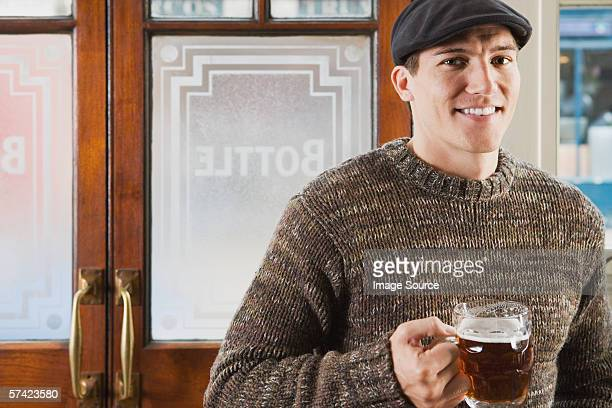 young man in pub - flat cap stock pictures, royalty-free photos & images