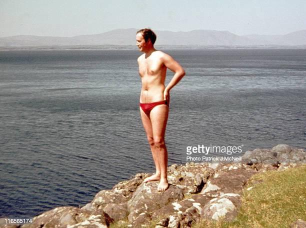 young man in red briefs beside scottish sea - junge in unterhose stock-fotos und bilder