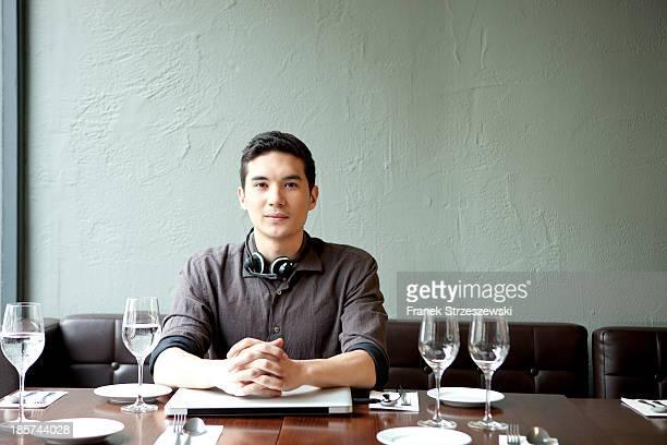 Young man in restaurant,  portrait
