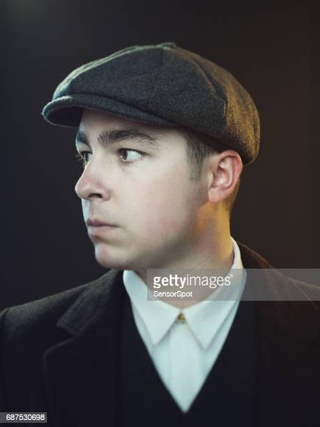 young man in retro peaky blinders suit - flat cap stock pictures, royalty-free photos & images