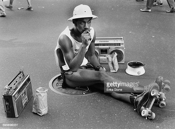 A young man in roller skates and a pith helmet New York City circa 1970