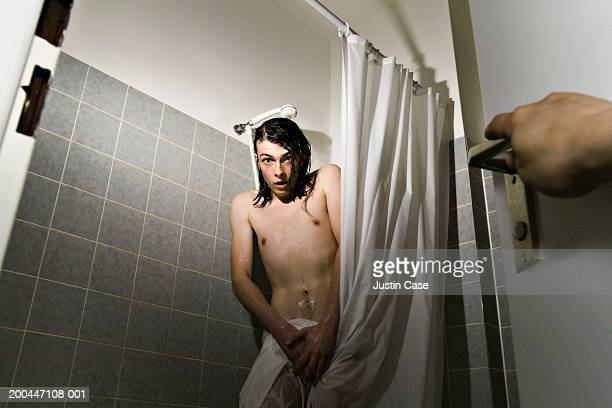 young man in shower, shocked expression on face as person enters room - adolescents nus - fotografias e filmes do acervo