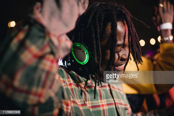 young man in silent disco - disco dancing stock pictures, royalty-free photos & images