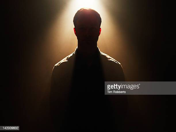 Young man in silhouette.
