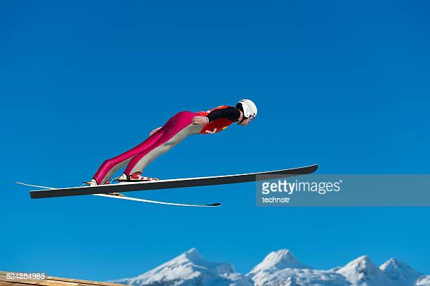 young man  in ski jumping action - ski jumping stock pictures, royalty-free photos & images