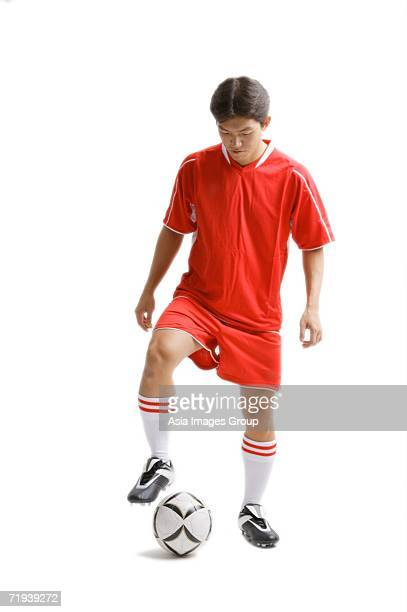 Young man in soccer uniform with soccer ball