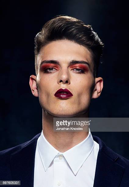 young man in strong make-up - eyeshadow stock pictures, royalty-free photos & images