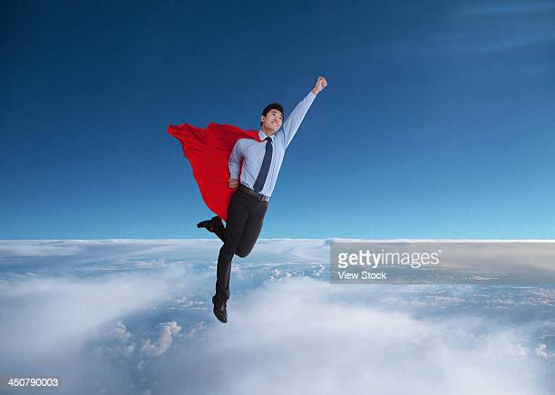 young man in superman outfit - cape garment stock photos and pictures