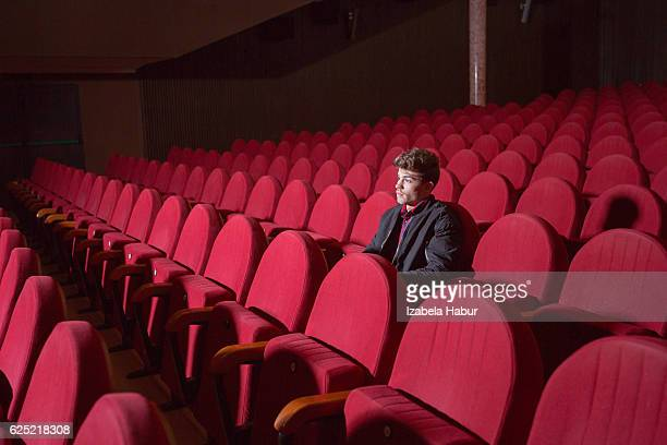 Young man in the cinema