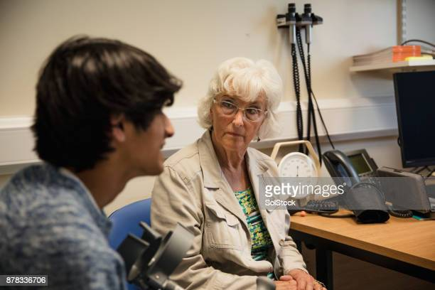 Young Man in the Doctor's Office with his Grandmother