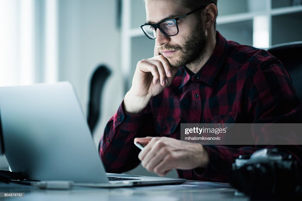 Young man in the office : Stock Photo
