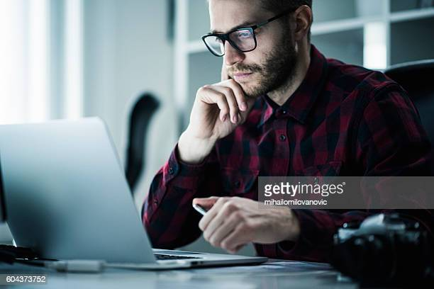 young man in the office - plaid shirt stock pictures, royalty-free photos & images