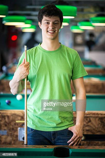Young man in the pool hall