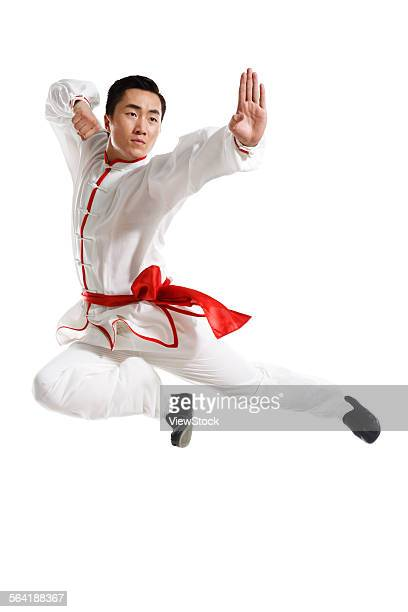 A young man in the practice Chinese Kung Fu