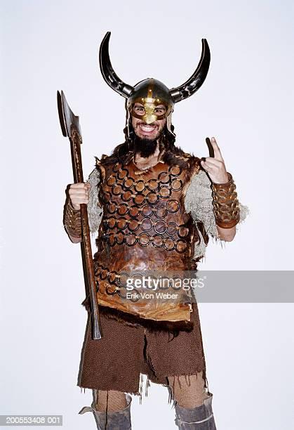 young man in viking costume against white background, smiling, portrait - wikinger stock-fotos und bilder