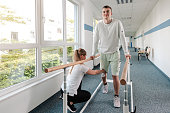 Young man in walking rehabilitation course after a sport injury