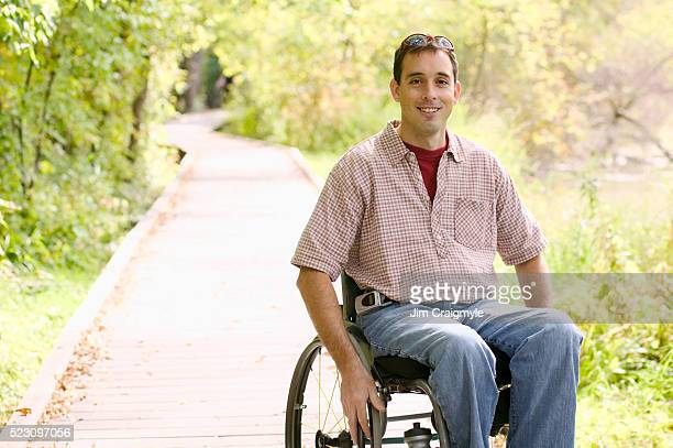 Young Man in Wheelchair at Park