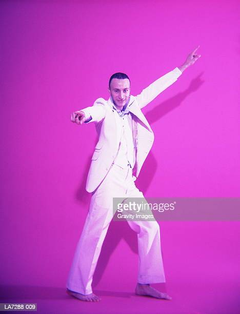 young man in white suit, disco dancing (digital enhancement) - disco dancing stock pictures, royalty-free photos & images