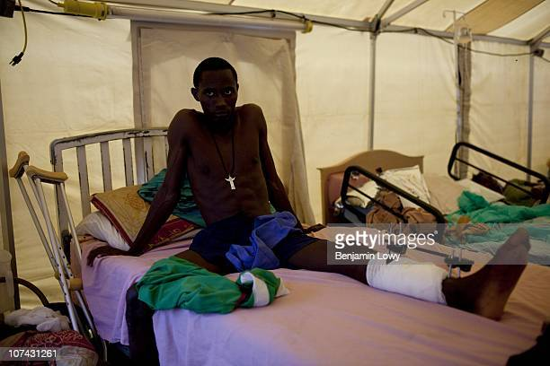 A young man injured during the earthquake sits on his bed in a medical tent at the Port au Prince General Hospital on January 31 2010 Haiti was...