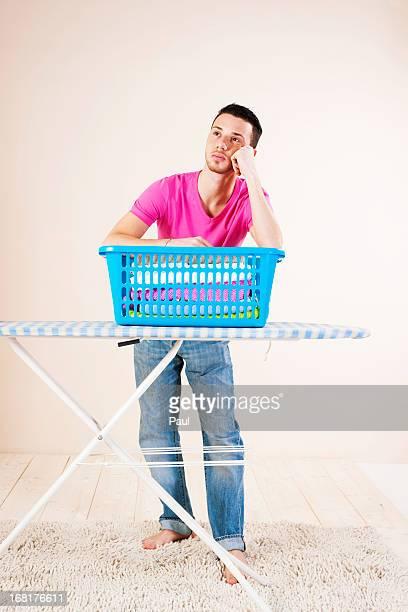 Young man ironing