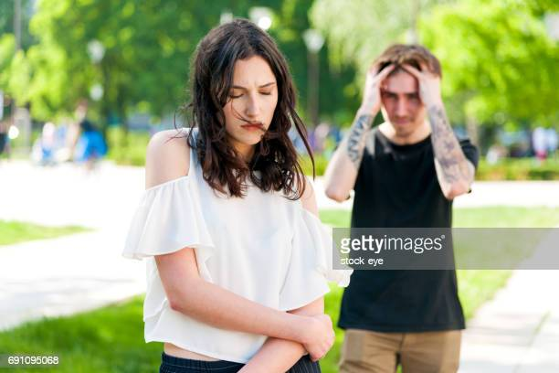 A young man is angry at his sad girlfriend