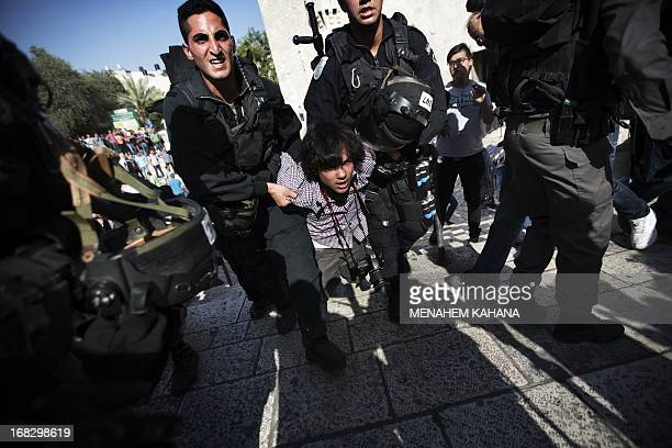 A young man is arrested by Israeli border policemen following a protest against Israelis celebrating Jerusalem Day on May 8 2013 at the Damascus gate...