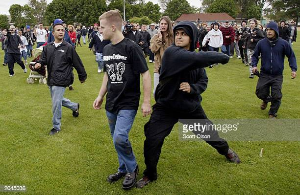 A young man is attacked as he flees the taunts of a pursuing mob following a Ku Klux Klan rally May 31 2003 in west suburban Chicago town of Berwyn...