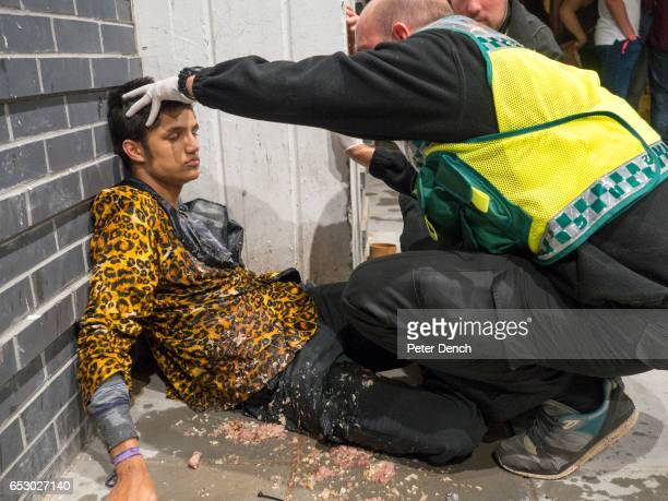 A young man is attended to by a paramedic outside the 02 Academy in Bristol where a Freshers week party is being hosted The University of Bristol is...