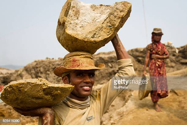 A young man is carrying huge load over his head and one hand at stone extraction site in Jaflong Sylhet Bangladesh on February 28 2015 Sylhet is a...