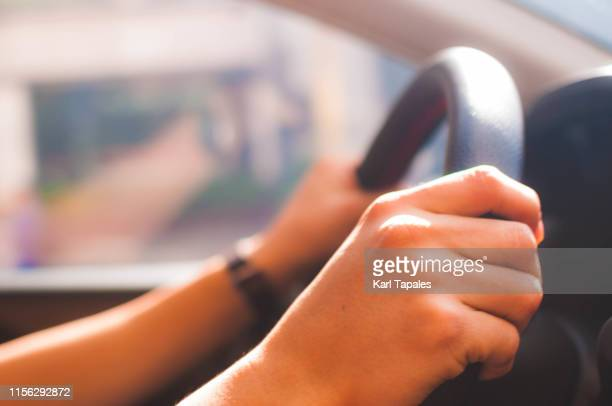a young man is driving a car - vehicle interior stock pictures, royalty-free photos & images