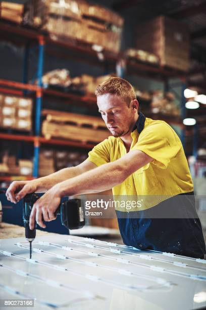 Young man is employed in manufacturing business in Australia