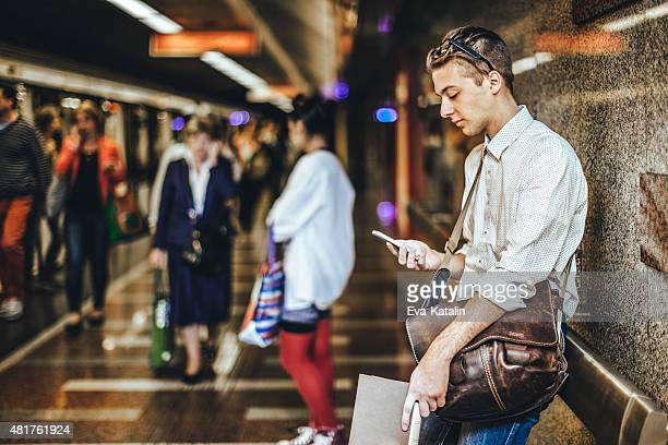 Young man is messaging on the underground