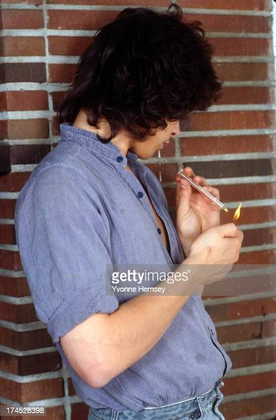A young man is photographed lighting a crack pipe May 20 1986 in New York City