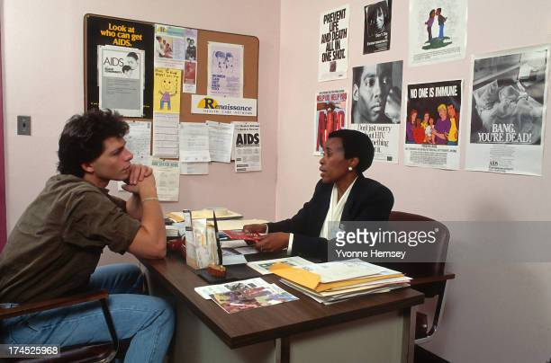 A young man is photographed receiving AIDS prevention counseling October 30 1986 at a Renaissance Health Care Network Diagnostic and Treatment Center...