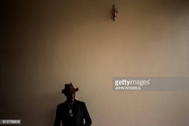 TOPSHOT A young man is seen ahead of a welcoming ceremony for first year students on February 3 2018 in Beni / AFP PHOTO / JOHN WESSELS