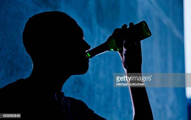 A young man is seen drinking from a beer bottle on August 13 2014 in Berlin Germany
