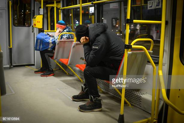 A young man is seen using his mobile phone in a tram in Warsaw Poland on February 20 2018