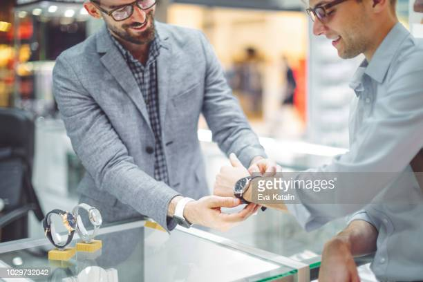 young man is shopping for a watch - jewellery stock pictures, royalty-free photos & images