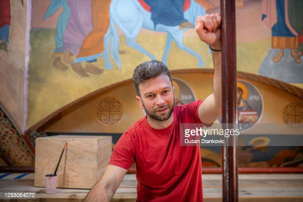 young man is standing in a church - dusan stankovic stock pictures, royalty-free photos & images