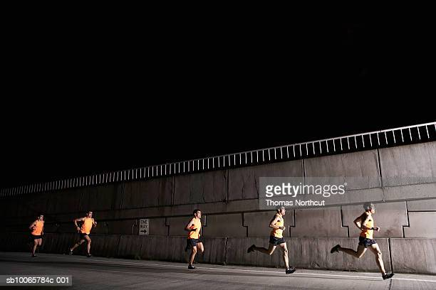Young man jogging at night (multiple exposure)