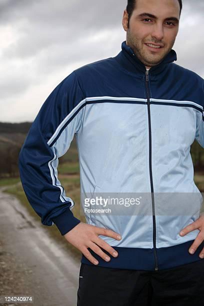 young man jogging in sportswear, three quarter length - three quarter length ストックフォトと画像