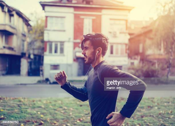 Young man jogging in the city