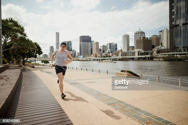 Young Man Jogging on Brisbane Southbank