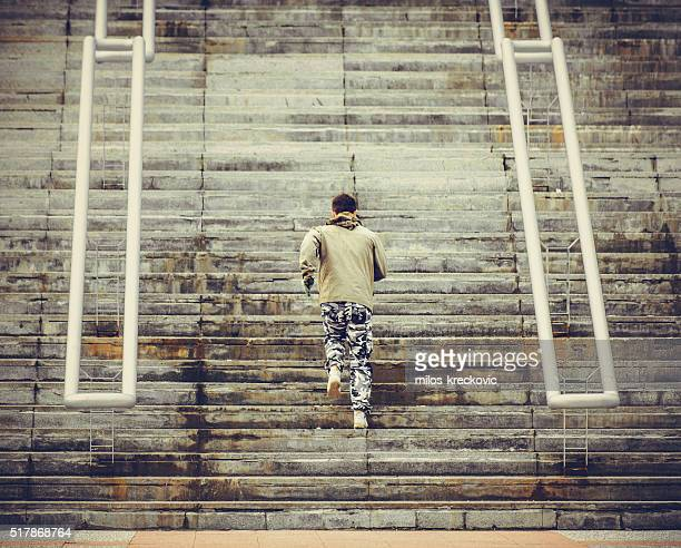 Young man jogging on stairs.
