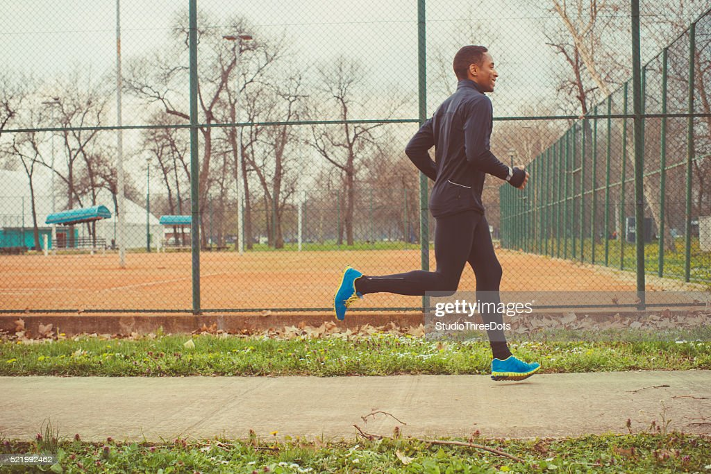 young man jogging outdoor : Stock Photo