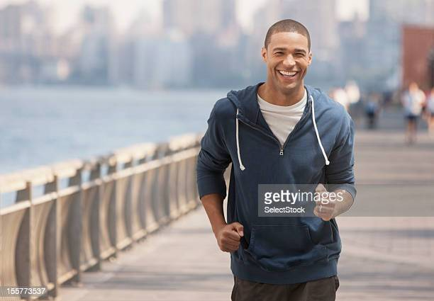 young man jogging outdoors - hoboken stock pictures, royalty-free photos & images