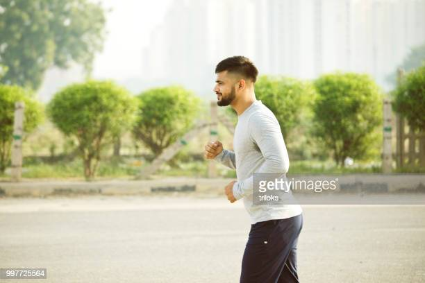 young man jogging city street fresh