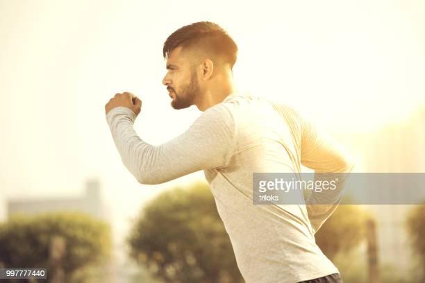 young man jogging city street fresh